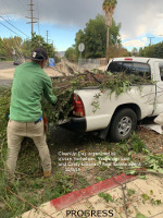 volunteer putting debris in truck bed